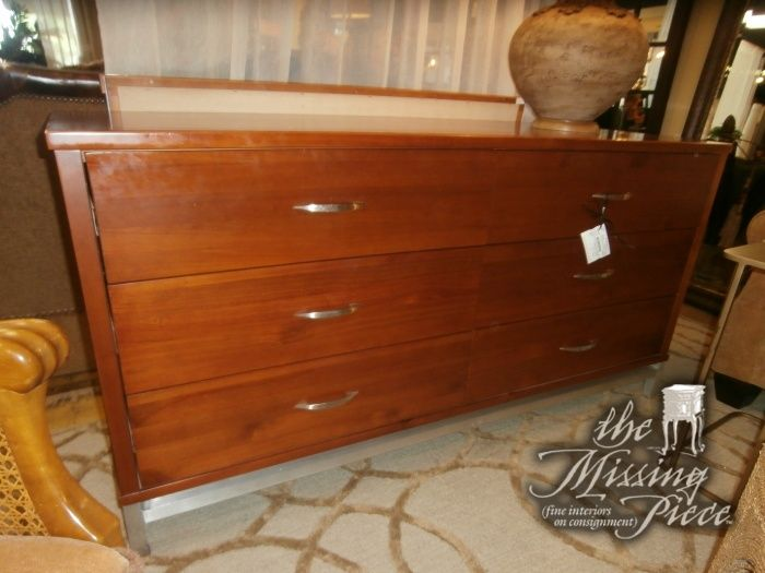 Contemporary dresser in blonde with silver trim and matching mirror. Measures 54*21*31.