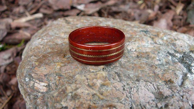 Padouk ring with brass inlay.