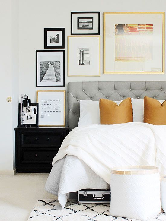 Think outside the box when hanging your next gallery wall collection. Although hallways and blank walls are natural areas to pin up art in a home, consider other places, like above your headboard or even above the commode. By situating the framed pieces in a free-flowing format around furniture and fixtures, they seamlessly integrate into your surroundings./