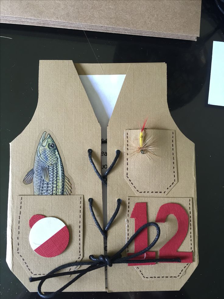 Handmade Gone fishing birthday party invitation! Fly fishing lure in one pocket. Bobber cut using a circle punch, fish sticker in another. Hand cut the number 12, small hole punch for the lacing and some string.