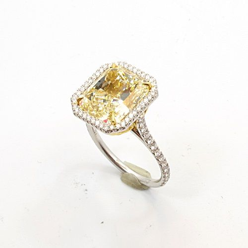 Canary diamond ring. 6 cts only $200k...this is what Ryan gosling is going to get me when he proposes hehe ;)