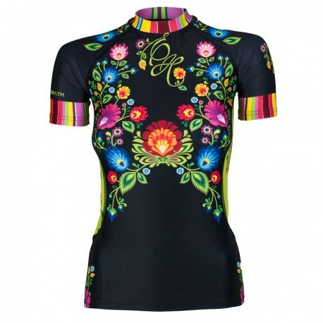 Short sleeve rashguard women FOLK. Color: black with colorful flowers. Excellent quality rashguard HOBBY EXTREME is ideal for hard training people who appreciate the highest class of products. Made of high quality material, which, thanks to its flexibility, clings to the body. Sophisticated thermoregulation system by which the body is dry and the muscles warmed up. Sublimated logos (will not scratch)..