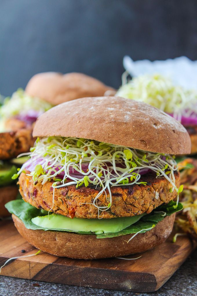 Gluten free & vegan chickpea burgers made with fresh basil, sun dried tomatoes, and ground almonds.