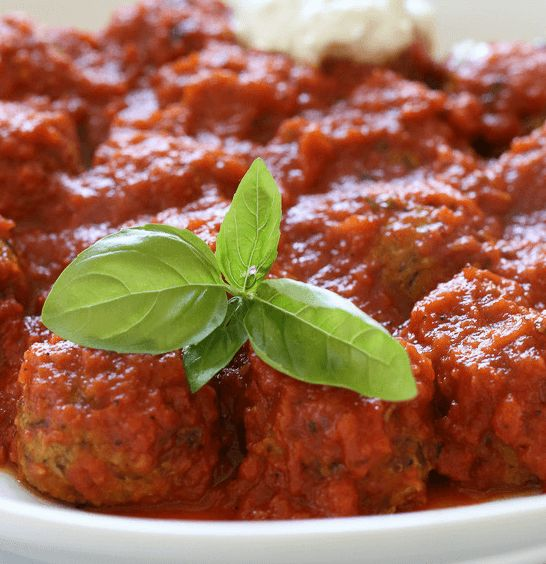 This Zucchini Meatballs recipe is shredded zucchini mixed with garlic, Pecorino Romano, basil, bread crumbs and egg, then baked in the oven and finished in a pomodoro sauce. Enjoy!