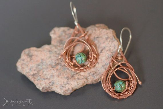 """Orbit - OOAK  My favourite freeform pair to date!  Soldered copper wire frames, surrounding a 7mm turquoise bead orbited by copper wires.  Length: 5cm/2""""  ** All my ear posts are made of sterling silver and are nickel free."""