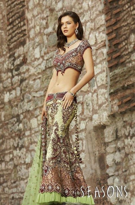 Red. It's so beautiful I love there collection ♥  Hindu / indian bride Wear saree, lehenga, choli from seasonsindia. the model is Neha Dalvi or Maria Sokolovski