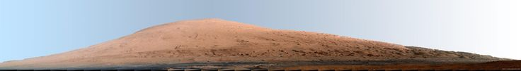 This mosaic of images from the Mast Camera (Mastcam) on NASA's Mars rover Curiosity shows Mount Sharp in a white-balanced color adjustment that makes the sky look overly blue but shows the terrain as if under Earth-like lighting. The component images were taken during the 45th Martian day, or sol, of Curiosity's mission on Mars (Sept. 20, 2012). Image released March 15, 2013.
