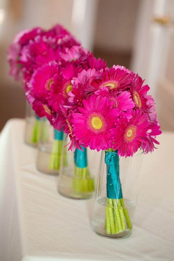 bridesmaids bouquets from a hot pink and teal wedding