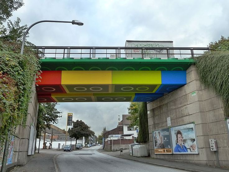 The LEGO-Brücke (English: LEGO Bridge) is a concrete beam bridge which crosses over the Schwesterstraße in the North Rhine-Westphalian city of Wuppertal, Germany. In 2011, graffiti and street artist Martin Heuwold repainted the bridge in the style of Lego bricks, receiving national and international media attention for his work. The work was awarded the Deutscher Fassadenpreis Advancement Prize in 2012.