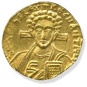Gold solidus showing a bust of Jesus with a cross behind his head and holding a Bible. Minted in Constantinople (modern-day Istanbul, Turkey), AD 705–711.Trustees of the British Museum
