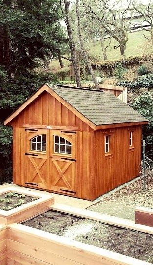 10'x12' Garden Shed with Board & Batten Siding, Cedar Stain, Carriage House Doors and Ridge Vent--Lafayette, CA http://www.backyardunlimited.com/sheds/garden-sheds