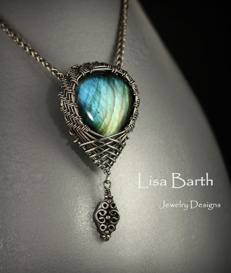 Tried a new thing today, made a woven bezel pendant upside down, with the criss cross at the bottom and a drop of silver off the end.  There is a double hidden bail on the back. --Lisa Barth