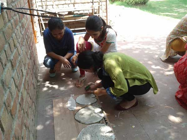 Learning how to make fossils (impressions of the leaves) Workshop: Whispers of Nature; Facilitator: Sunaina; Venu: The Gnostic Centre; Date: 17 Aug 2014; Participates: Students (Ecology group), Gargi College, Delhi University.