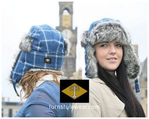 Trapper hat. Our super warm and cosy trapper hat in bespoke blue and white tweed. With quilted lining and premium faux fur trim. turnstylewear.com