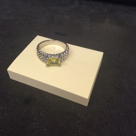 Yellow stone diamond candle ring Yellow stone fashion ring with a detailed accent around part of the ring. From a diamond candle Jewelry Rings