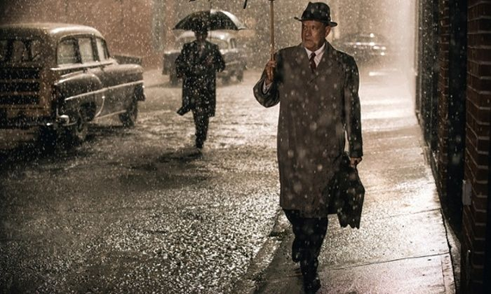 Bridge of Spies review – cold war, warm wit. Spielberg brings humour to the spy thriller genre, while Mark Rylance and Tom Hanks add odd-couple chemistry. With a surprisingly understated score from Thomas Newman and spot-on production design by Adam Stockhausen, the movie is an elegant, intelligent slice of popular entertainment that peppers its gripping intrigue with winning wit and humour. It also manages to make a modern hero out of an insurance lawyer.