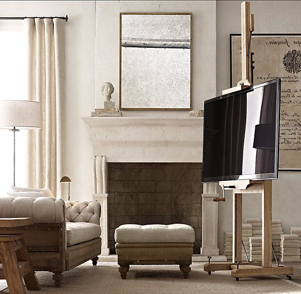 Flat-screen TV stand from a 19th Century English Artist's Easel (repro) by Restoration Hardware. Great films-are-art idea.