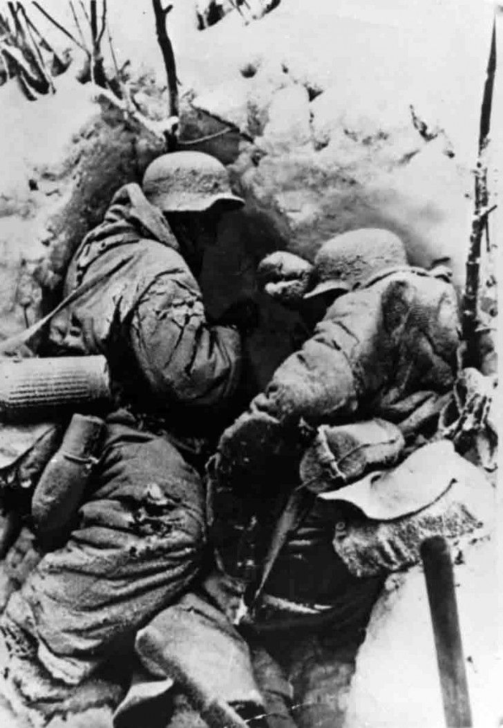 Frosted bodies of two German soldier`s from the 6th Army , of the Field Marshal Friedrich von Paulus , in full combat gear - at firing position during the Battle of Stalingrad 1942