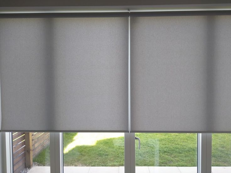 The 2 roller blinds fitted to these french doors were installed with a centre joining bracket so that there is a minimal gap between the blinds. http://www.theblindshop.com