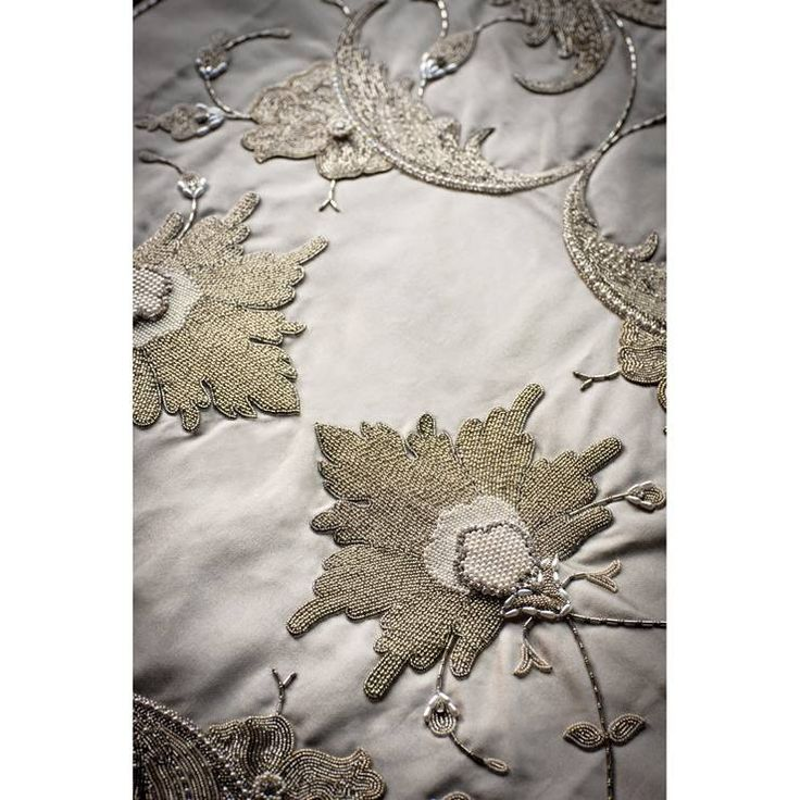 Rigoletto hand embroidered fabric. A wonderfully glamorous design that would look wonderful on curtains or back of dining chairs.