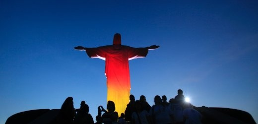 Christ the Redeemer on top of Mount Corcovado in Rio de Janeiro was bathed in black, red and gold on Wednesday to celebrate the anniversary of German reunification 22 years ago on, October 3, 1990. The statue has been lit up in color before but, according to Harald Klein, German consulate general in Rio de Janeiro, it's the first time the 39.6 meter (130 foot) statue was lit up with multiple colors, let alone the colors of another country.