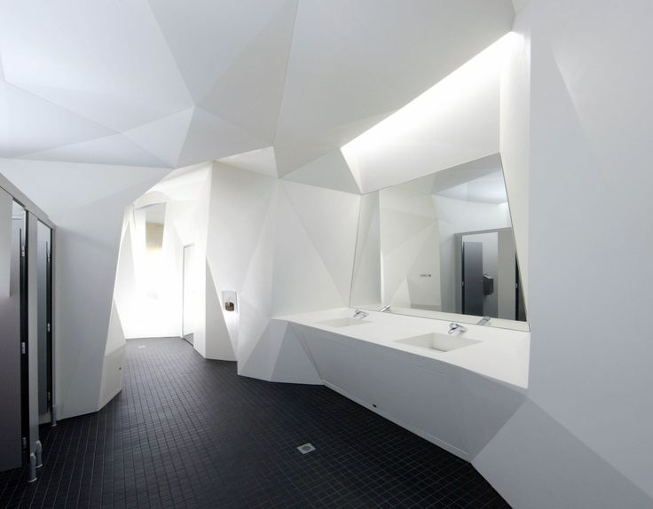 Architecture faceted walls by coniglio ainsworth architects 2011 corian design awards grand Public bathroom design architecture
