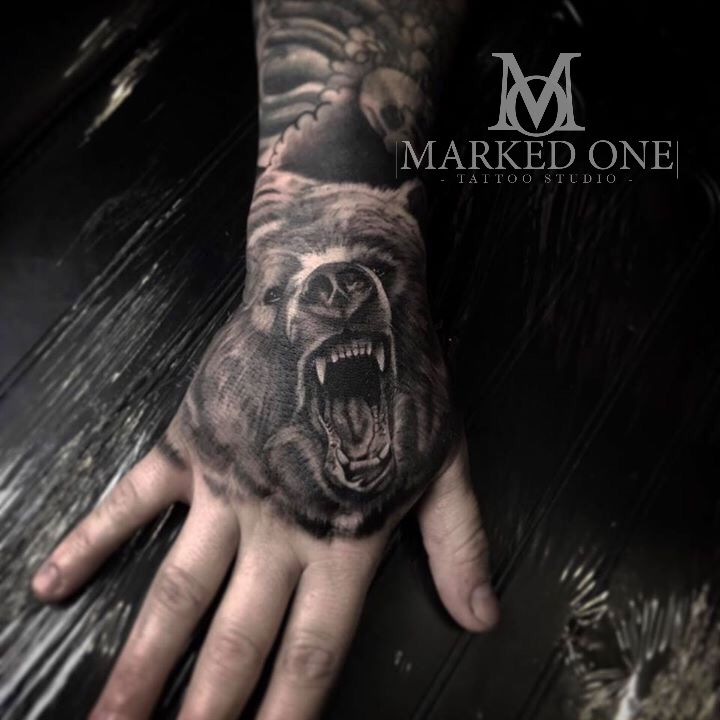 Hand tattoo by Adam Thomas. Animal tattoo. Detailed black and grey Bear.