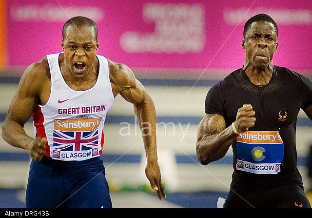 Glasgow, Scotland, UK. 25th January 2014. James Dasaolu wins Men's 60 metres race ahead of Dwain Chambers at Glasgow International Athletics. Credit Steven Scott Taylor / Alamy Live News