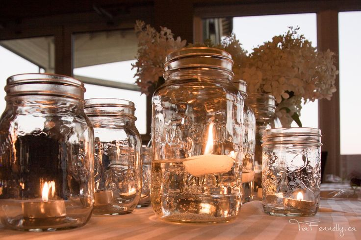 Center pieces - mason jars and floating candles