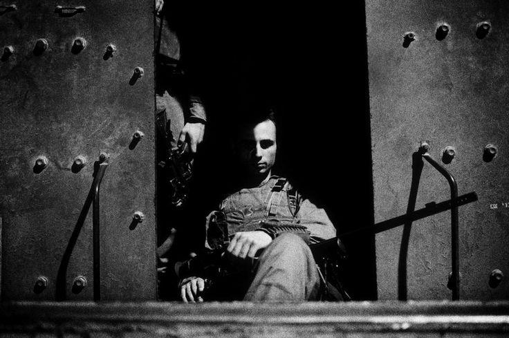 Paolo Pellegrin. GAZA. An Israeli (IDF) sniper inside an armoured vehicle leaves a military base to go lay an ambush inside Rafah. 2004
