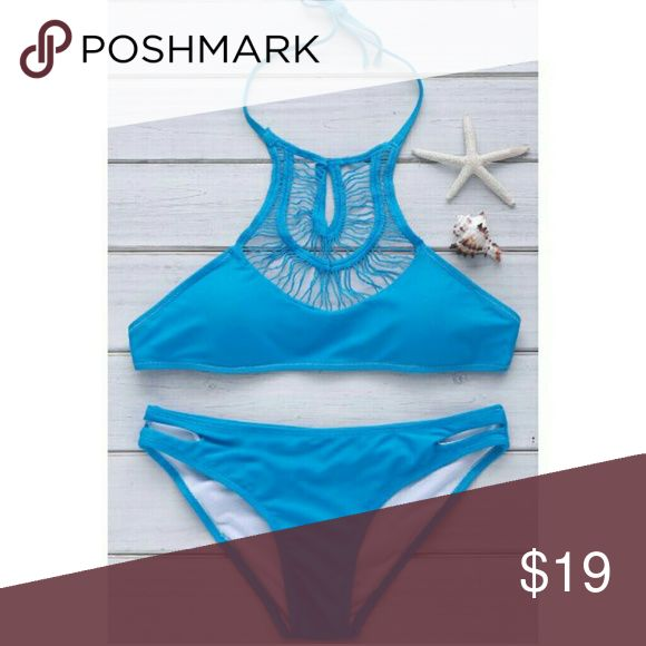 New Beach Blue Bikini.  Halter Top  Style Brand new HOT Beach Blue Bikini.   Halter Style Top with Lace Cut-outs.  Perfect Beach Blue Color.  Form flattering with support. Bundel and Save.  Happy Poshing. Beach Blue Swim Bikinis