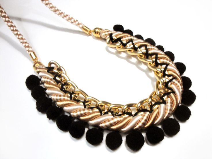Pompom necklace in black, cream and gold by Beh1ndByMK on Etsy https://www.etsy.com/listing/164656725/pompom-necklace-in-black-cream-and-gold