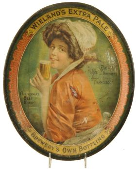 """Tin litho pre-pro advertising beer tray for John Wieland Brewery of San Francisco California manufactured by the H.D. Beach Co. of Coshocton Ohio. Tray features scene of a Victorian woman drinking from a beer glass in an over the shoulder pose. Tray border advertises Wieland's Extra Pale Brewery's Own Bottling. Tray has numerous areas of wear to the field, please view images closely to judge condition. size: 16.5"""" x 13.5"""""""