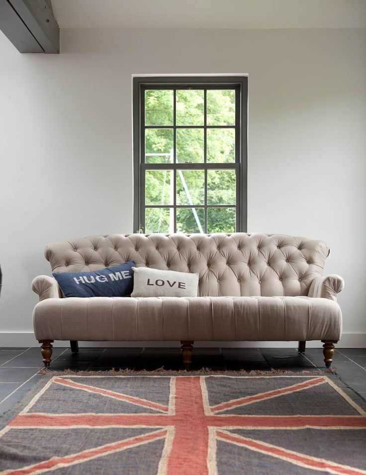 This gorgeous neutral linen three seater sofa would work with most room schemes. It has a deep seat which makes it the perfect sofa to curl up on. With its pretty button detail and beautiful curves it will add timeless chic to your room. Comes with 5 large scatter cushions. Pair it with a matching armchair to complete the look.'Hug me' and 'love' cushion sold separately.