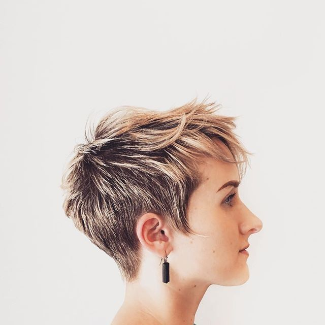 We love this cute textured pixie cut by Aveda Artist Emily at Juut Salonspa.