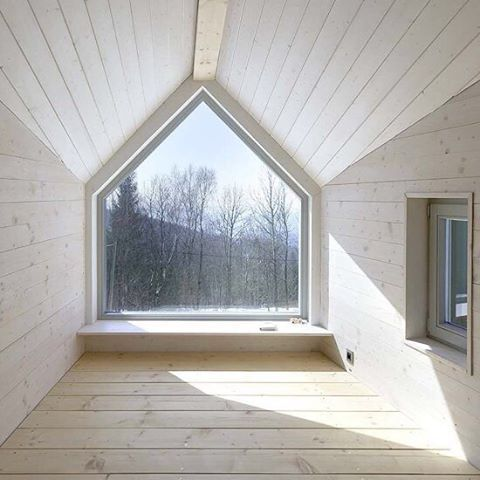 the lolling space: the marsh house, jizerska, czech republic by a1 architects   the traditional architecture includes a tall gabled roof that has created a long dormer viewing window & a special space to loll.