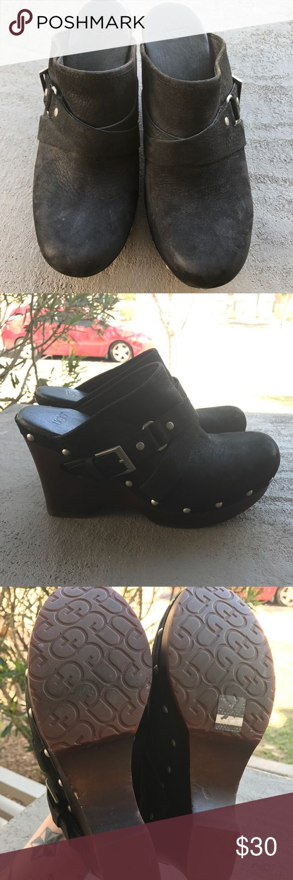 """UGG Black Leather Natalee Belted Wedge Clogs A 4-inch, sculpted bass-wood wedge stands out with slotted midsole, crisscross buckled straps, and rugged rivet accents. Nubuck leather upper criss cross belted detail, metal buckle and rivets Criss cross belted detail, metal buckle and rivets Dome shaped nailhead detail on midsole Outsole: 4"""" bass wood midsole with a 1"""" platform Slotted wood midsole construction This product contains real fur from Sheep or Lamb that has been artificially dyed and…"""