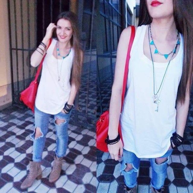 Diy ripped jeans. Cool pair of boots and a beautiful touch of red.