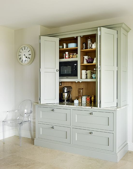 Each cabinet has been thoughtfully planned and includes bespoke features   Kitchen designed by Toni Silver of martinmoore.com   Homes & Gardens   Photograph Darren Chung   http://www.hglivingbeautifully.com/2016/04/27/dream-rooms-a-carefully-composed-kitchen-in-worcestershire/