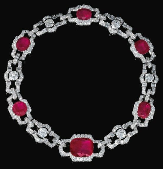 RUBY AND DIAMOND NECKLACE, 1930S. Designed as a series of geometric links set with cushion-shaped rubies, circular-, single-cut and baguette diamonds, length approximately 345mm, separates into two bracelets, lengths approximately 175 and 170mm, each with French assay and maker's marks, one small diamond deficient.