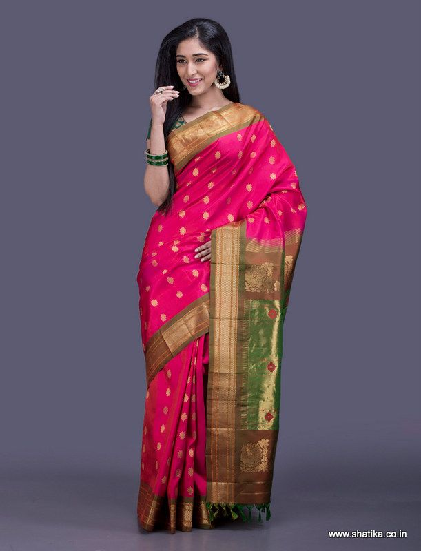 A true testament of Paithani Sarees, the bold golden bootis and the ornate pallu on this Paithani saree look ethereal. Paithani silk uses the ancient technique of tapestry where multiple threads of different colours along with gold and silver threads are weaved together to form a fascinating piece of silk.