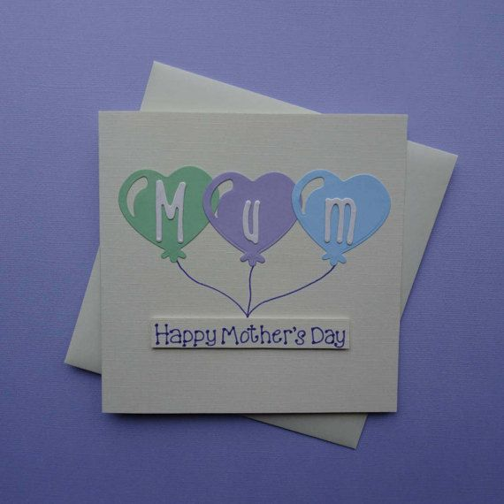 Mothers Day card, featuring three heart shaped balloons with the name Mum in each balloon. This would also make a great birthday card for Mum.  This Mothering Sunday card has pastel heart shaped balloons. The sentiment on this balloons birthday card for Mom is added with 3D foam and reads: Happy Mothers Day. You can also choose an alternate message making this a great handmade birthday card.  PERSONALISING YOUR CARD: You can choose the colour of the ballons, and if you choose a single…