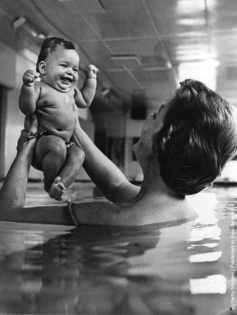A mother teaching her 17-week old baby daughter to swim, 1966