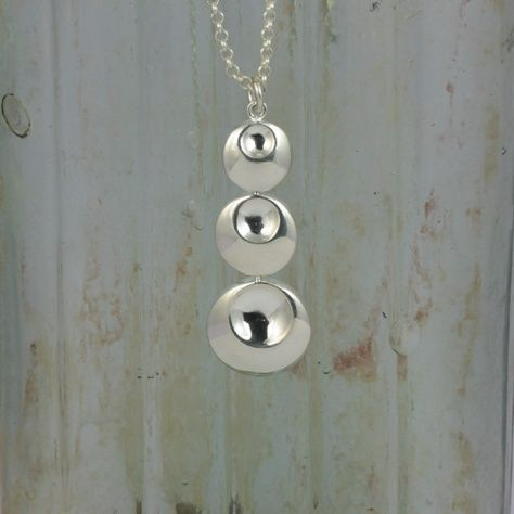 Eclipse Pendant £31.00 A stunning silver pendant designed with a dimple design to catch the light All of our silver jewellery comes packaged in a pretty gift box.  Sterling Silver  Size: 15 X 55 mm 40 mm Silver Chain Included