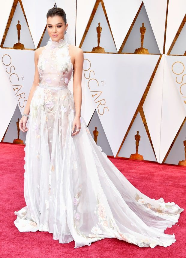 2017 Oscars: Hailee Steinfeld is wearing a white/ pastel Ralph & Russo gown with a high neckline and floral appliques. Youthful, elegant, and feminine! I love this dress! Hailee has been nailing it at this years award show season!