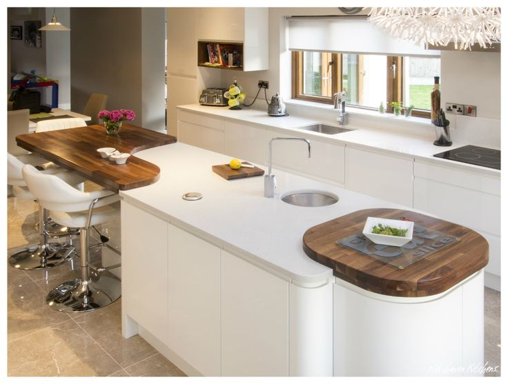 White Gloss Handleless Island with Prep Sink & Cubic Tap.  Curved Doors with Walnut Butchers Block.  Solid Walnut Curved Feature Worktop
