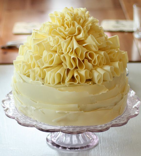 Delicious chocolate mud cake with swiss meringue buttercream icing topped with white chocolate ruffles! by Amelia George Cakes