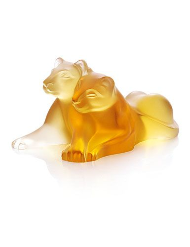 Lalique Amber Tambwee Lion Figures. I love the clear version I have of this piece