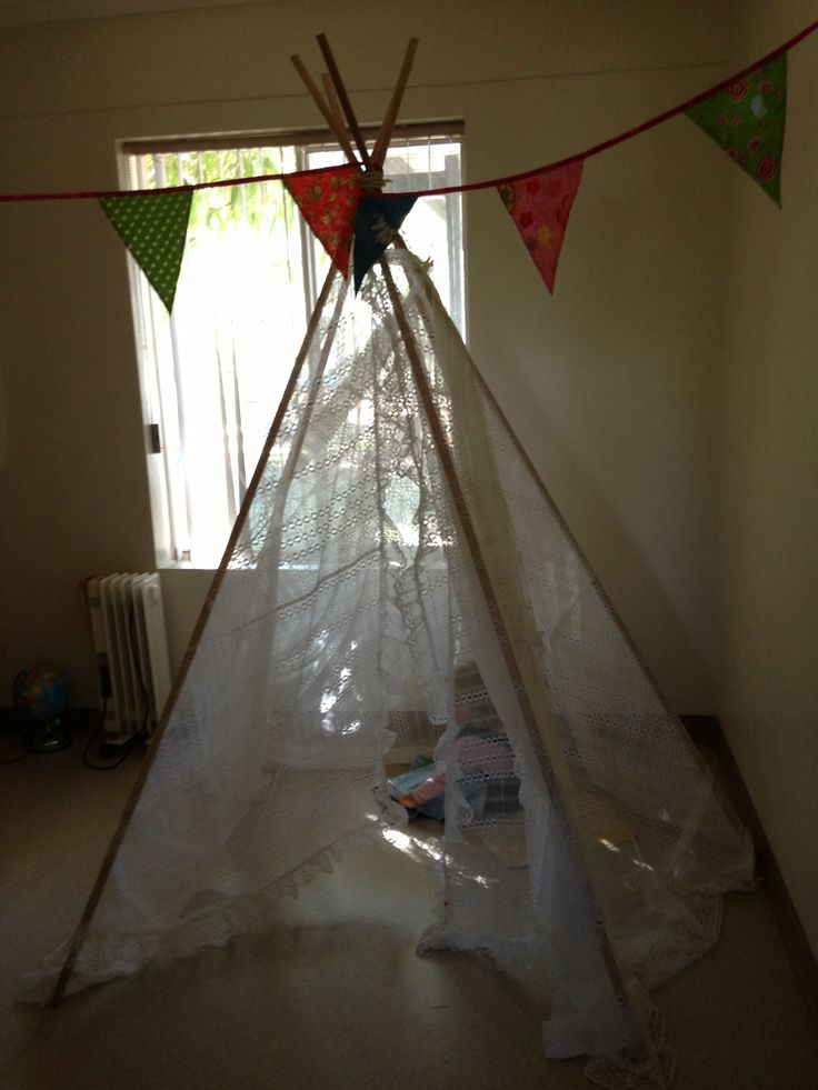 Teepee using doweling rods and a net curtain. My little ones love it.