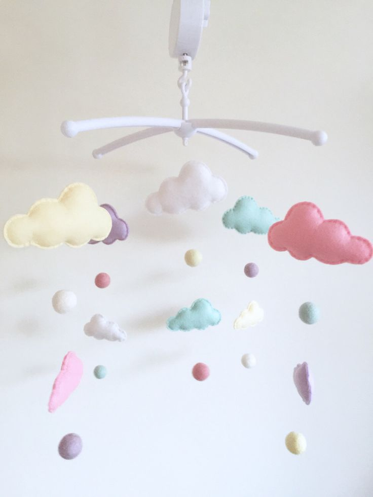 Pastel Clouds Musical Cot Mobile, Pastel Baby Mobile, Cloud Nursery Mobile, Cloud Nursery, Nursery Decor, Baby Mobile, Musical Cot Mobile by xCrazyLittleCraftsx on Etsy https://www.etsy.com/uk/listing/470628821/pastel-clouds-musical-cot-mobile-pastel